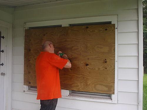 Sean boarding up windows - just as a precaution.